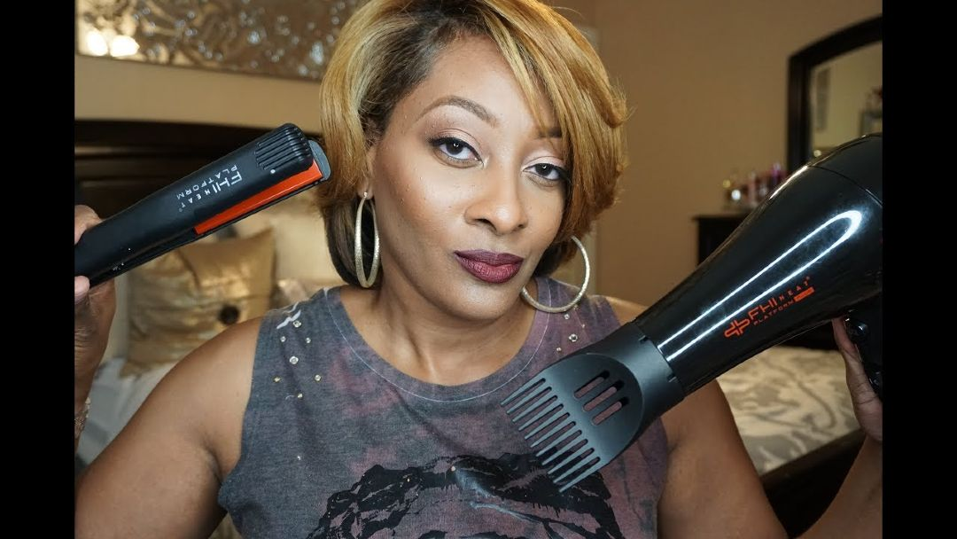 woman holding a fhi straightener and dryer