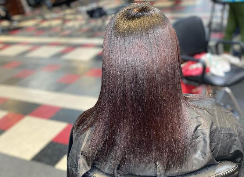flat ironed relaxed hair