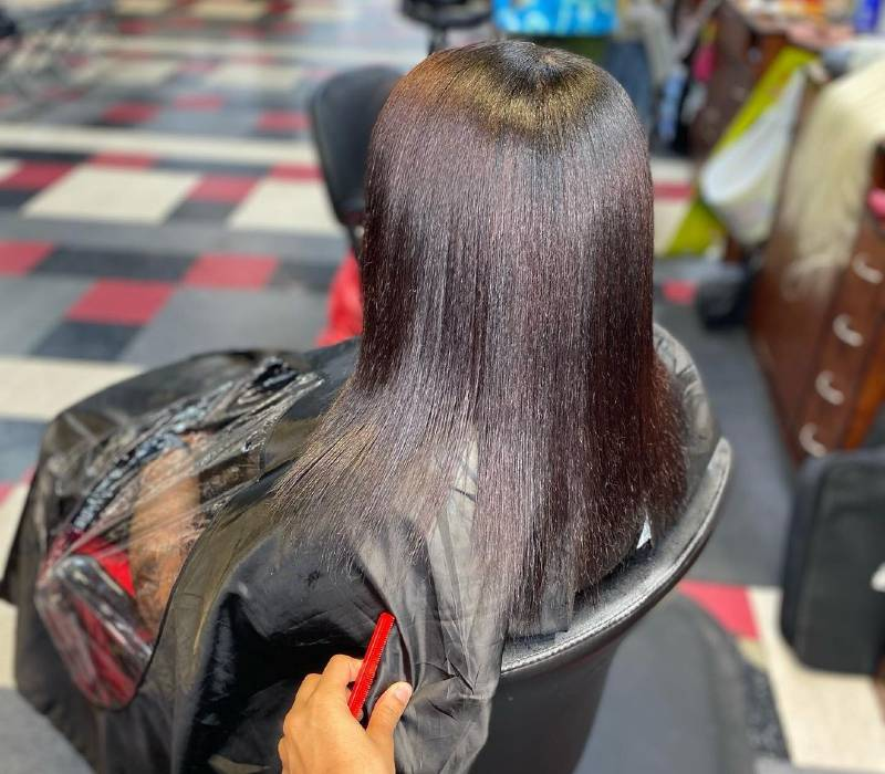 relaxed hair straightened with flat iron and heat protectants
